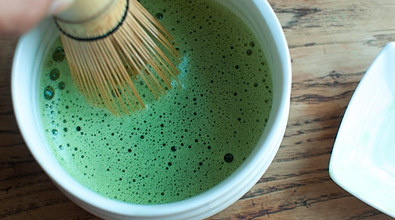 matcha with whisk last step of making matcha green tea