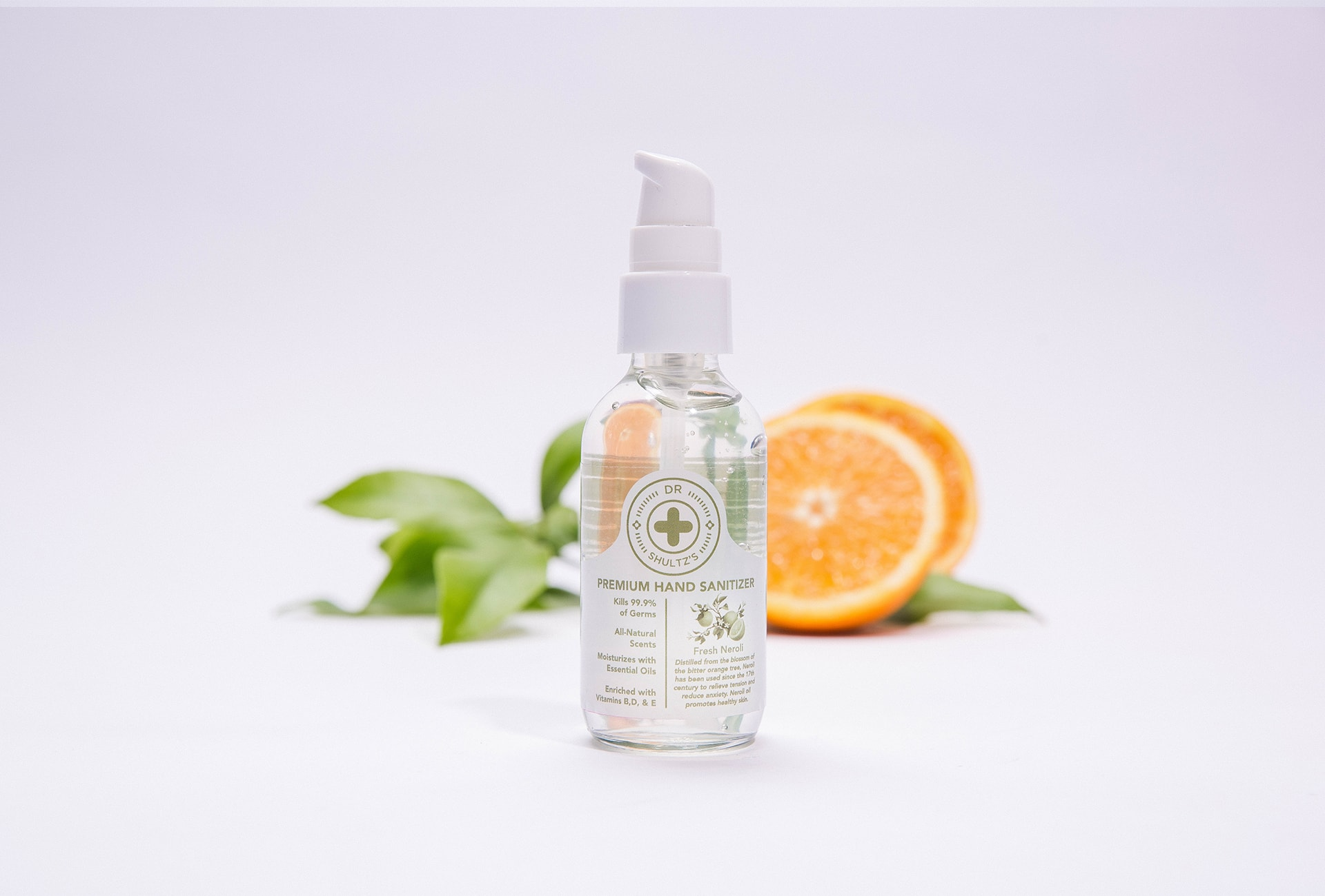 Studio Photo Shultz Hand Sanitizer Next To Moisturizing Neroli Essential Oil